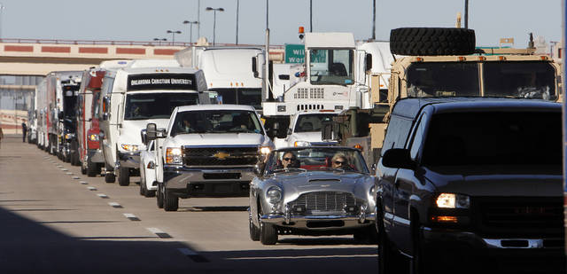 A convoy of vehicles cross under the Western Avenue Bridge during grand opening ceremonies for the eastbound lanes of the I-40 Crosstown in Oklahoma City Thursday, Jan. 5, 2012. Photo by Paul B. Southerland, The Oklahoman