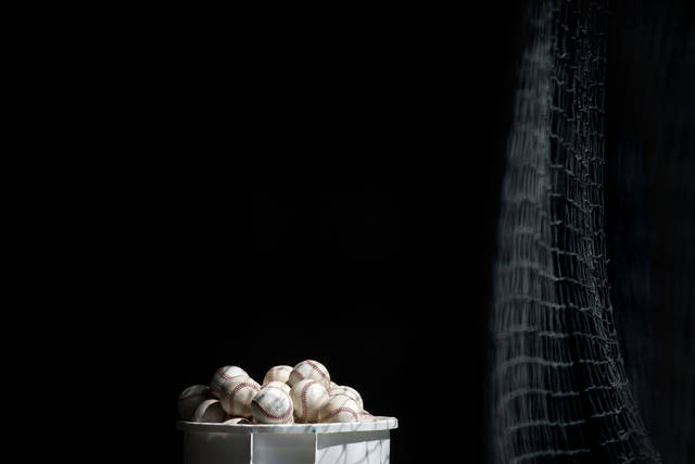 A bucket of baseballs sit in the batting cage after a Minnesota Twins spring training baseball workout, Tuesday, Feb. 19, 2013, in Fort Myers, Fla. (AP Photo/David Goldman)