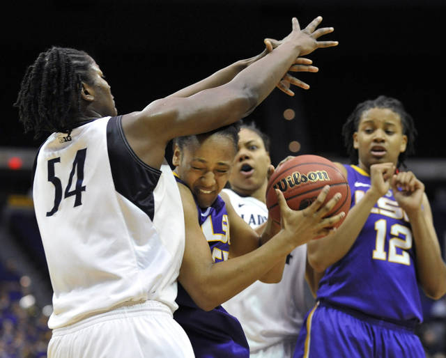 LSU forward LaSondra Barrett (55) battles for control of a rebound with Penn State center Nikki Greene (54) as Penn State forward Mia Nickson (24) and LSU forward Krystal Forthan (12) watch during the first half of a second-round NCAA women's tournament college basketball game, Tuesday, March 20, 2012, in Baton Rouge, La. (AP Photo/Bill Feig)