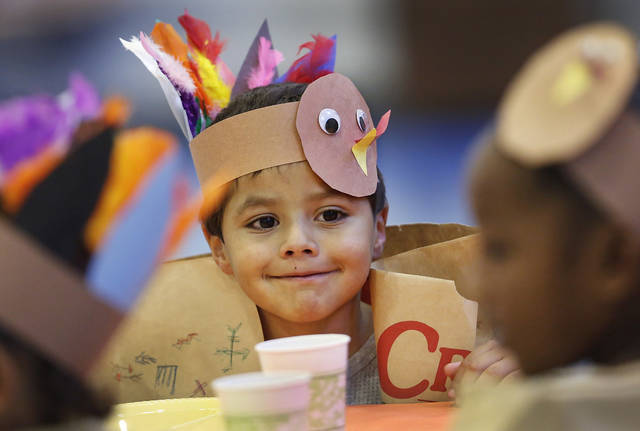 Daniel Rodriguez waits for the pumpkin pie to be served. Kindergarten students at Eugene Field Elementary School in Oklahoma City have been learning about Thanksgiving traditions and  the history of the national  holiday in America.  Their teachers helped them make paper sack vests and turkey head pieces to wear.  To celebrate the end of the Thanksgiving lesson and reward the students for working so hard, about 80 students in the four kindergarten classes held a pumpkin pie break in the cafeteria Tuesday afternoon, Nov. 20, 2012. The students dressed in their creative paper sack turkey vests and head dresses.   Photo by Jim Beckel, The Oklahoman