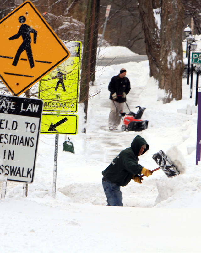 Elder Fernandez shovels a sidewalk along Bedford Road in Katonah, N.Y., Saturday, Feb. 9, 2013. The year's first major winter storm dumped up to 21 inches on the Lower Hudson Valley.  (AP Photo/The Journal News, Frank Becerra Jr.) NYC OUT, NO SALES, ONLINE OUT, TV OUT, NEWSDAY INTERNET OUT; MAGS OUT