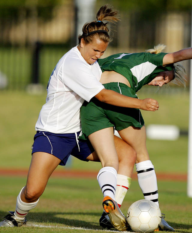 Metro Christian's Jordan Johnston (13) Bishop McGuinness' Jacquelyn Elmer (7) in the second half during the Class 4A girls championship high school soccer game between Tulsa Metro Christian and Bishop McGuiness, in Tulsa, Okla., Saturday, May 10, 2008. BY MATT STRASEN, THE OKLAHOMAN
