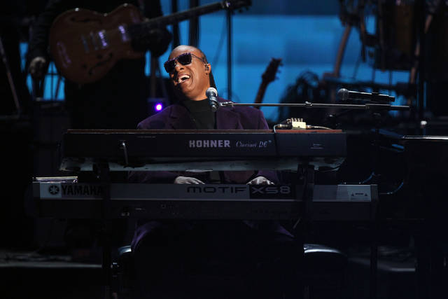 Stevie Wonder and the Rickey Minor Band perform �Master Blaster�, �My Cherie Amour� and �Sir Duke� as a tribute to Dick Clark at the 40th Anniversary American Music Awards on Sunday, Nov. 18, 2012, in Los Angeles. (Photo by Matt Sayles/Invision/AP)