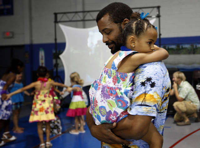 Jamaal Jackson dances with his daughter Julia, 4, during a Daddy Daughter Dance at the Moore Community Center, Saturday, June 16, 2012. Photo by Sarah Phipps, The Oklahoman