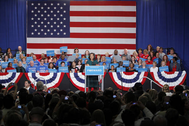   First lady Michelle Obama campaigns for her husband, President Barack Obama, at a rally at the Douglas County Fairgrounds in Castle Rock, Colo., Thursday, Oct. 11, 2012. (AP Photo/Ed Andrieski)  