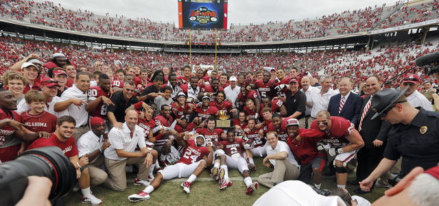 The Sooners pose for the team photo after the 63-21 win over Texas during the Red River Rivalry college football game between the University of Oklahoma (OU) and the University of Texas (UT) at the Cotton Bowl in Dallas, Saturday, Oct. 13, 2012. Photo by Chris Landsberger, The Oklahoman