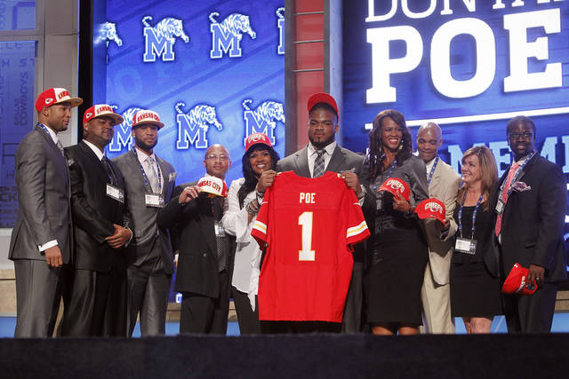 Memphis defensive tackle Dontari Poe poses for photographs with loved ones after being selected as the 11th pick overall by the Kansas City Chiefs in the first round of the NFL football draft at Radio City Music Hall, Thursday, April 26, 2012, in New York. (AP Photo/Jason DeCrow)