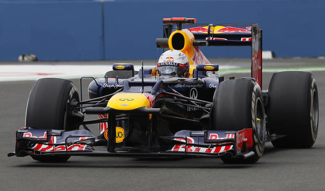 Red Bull's Sebastian Vettel from Germany drives his F1 racing car during the first test session at Valencia street circuit, Spain, Friday, June 22, 2012. The race European Formula One Grand Prix will take place on Sunday over the street circuit surrounding the city's port. (AP Photo/Andres Kudacki)