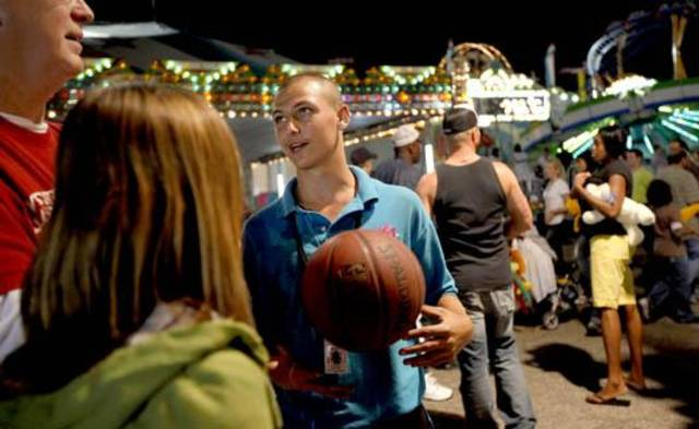 Carnival worker Charles Johnston works at the Oklahoma State Fair in Oklahoma City on Friday, September 18, 2009. Photo by Bryan Terry, The Oklahoman