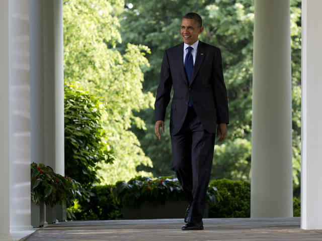 FILE - In this May 3, 2012, file photo, President Barack Obama walks from the Oval Office as he arrives to speak at a celebration of Cinco de Mayo in the Rose Garden of the White House in Washington. Despite a relentless workload ahead, President Barack Obama is lighter on his feet in one sense as he opens his second term. Gone are the hundreds of promises of the past. He�s toting carry-ons instead of heavy cargo this time. Failing to achieve a promised first-term overhaul of immigration law, Obama took stopgap executive action to help as many as 1.7 million younger illegal immigrants stay in the country, and now, after an election marked by Hispanic clout, finds the political landscape more amenable to trying again.  (AP Photo/Carolyn Kaster, File)