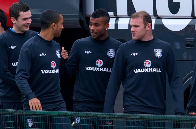 England's Ashley Cole, 2nd right, shares a joke with Theo Walcott, 2nd left, during a team training session, London Colney, Thursday Oct. 11, 2012. England will play against San Marino in a World Cup qualifying soccer match on Friday. (AP Photo/Tom Hevezi)