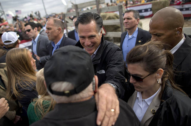 Republican presidential candidate, former Massachusetts Gov. Mitt Romney shakes hands during a campaign rally, Tuesday, Oct. 9, 2012, in Van Meter, Iowa. (AP Photo/ Evan Vucci)