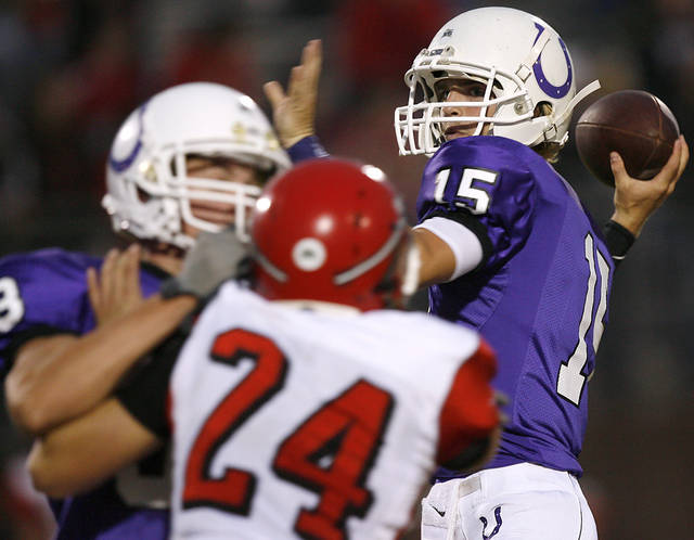 Bethany quarterback Ryley Claborn looks for an open receiver with pressure from Washington's Luke Hayes during their high school football game in Bethany, Okla., on Friday, September 16, 2011. Photo by John Clanton, The Oklahoman