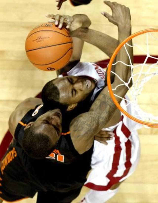 Amath M'Baye (22) and Cowboy's Le'Bryan Nash (2) go for a rebound as the University of Oklahoma Sooners (OU) defeat the Oklahoma State Cowboys (OSU) 77-68 in NCAA, men's college basketball at The Lloyd Noble Center on Saturday, Jan. 12, 2013 in Norman, Okla. Photo by Steve Sisney, The Oklahoman