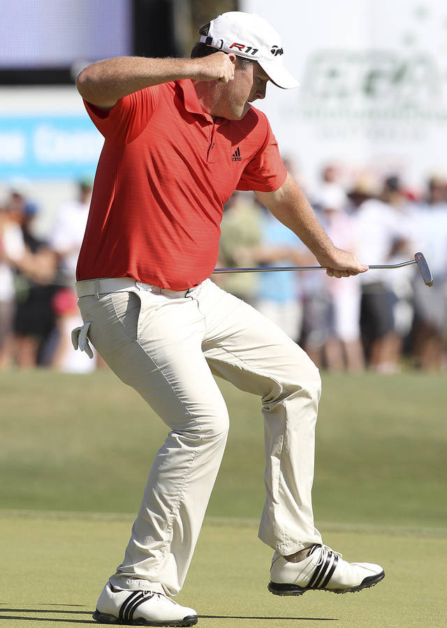 Australia's Marcus Fraser reacts after sinking a birdie putt on the 18th green to advance to a three-man playoff in the final round of the Australian PGA golf Championship at the Hyatt Regency in Coolum, Australia, Sunday, Nov. 27, 2011. (AP Photo/Tertius Pickard)