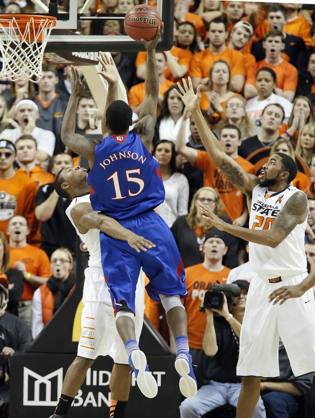 Oklahoma State 's Marcus Smart (33) defends on Kansas' Elijah Johnson (15) during the college basketball game between the Oklahoma State University Cowboys (OSU) and the University of Kanas Jayhawks (KU) at Gallagher-Iba Arena on Wednesday, Feb. 20, 2013, in Stillwater, Okla. Photo by Chris Landsberger, The Oklahoman
