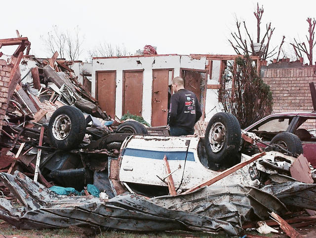 MAY 3, 1999 TORNADO: Tornado damage: Area of NW 27TH AND I-35 IN MOORE OKLA.  Steven Johnson looks over damage to his house at 2520 Ridgewood  (Nolans Clay's housing addition Highland Park) Just south of the First Baptist Church.  Steven and his family lost three houses in the area.