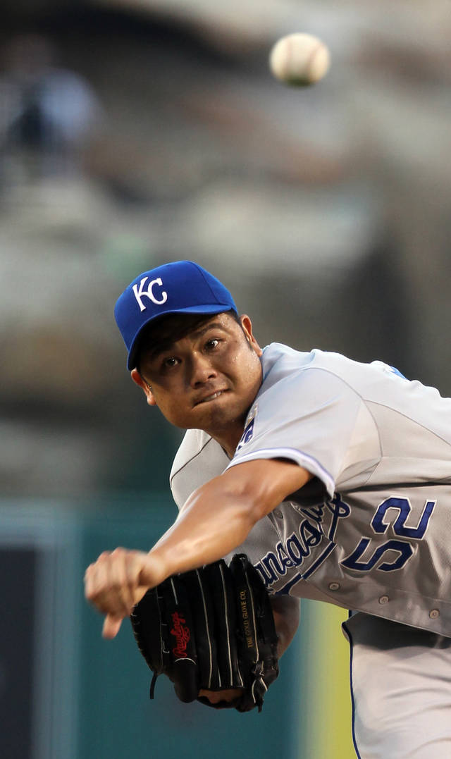 Kansas City Royals starter Bruce Chen pitches to the Los Angeles Angels in the first inning of a baseball game in Anaheim, Calif., Monday, July 23, 2012. (AP Photo/Reed Saxon)