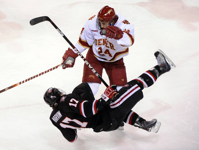 Denver defenseman Matt Donovan (24) levels St. Cloud State center Aaron Marvin (17) in the first period of a college hockey game Friday, March 4, 2011, in Denver. (AP Photo/The Denver Post, Karl Gehring) ** MAGS OUT  TV OUT **  ORG XMIT: CODEN302