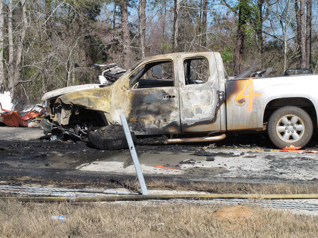 A smashed and burned pickup truck sits on Interstate 16 in middle Georgia hours after a 27-vehicle pileup snarled the highway Wednesday, Feb. 6, 2013. More than two dozen cars, pickup trucks and tractor-trailers collided Wednesday morning in a fiery pileup on a foggy Georgia interstate 16, killing at least three people and sending nine others to a hospital, officials said. (AP Photyo/Russ Bynum)