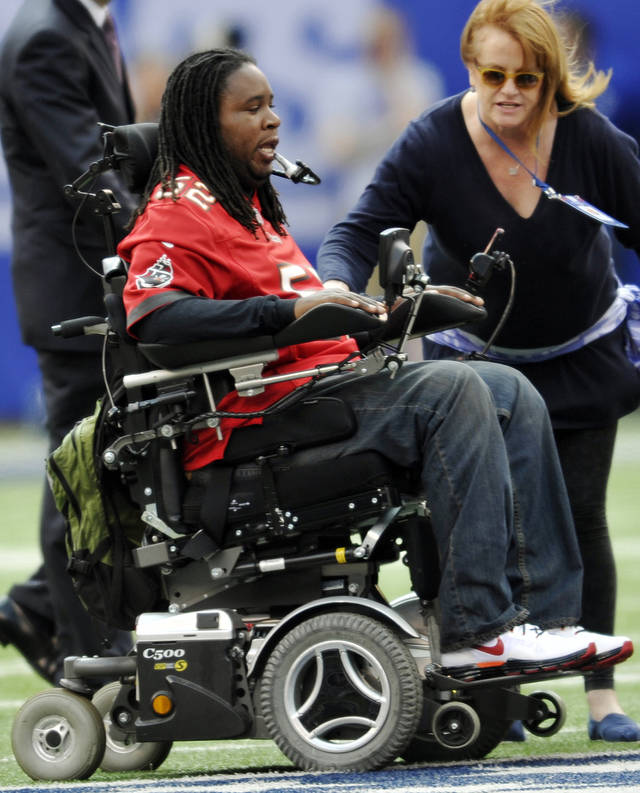 Paralyzed former Rutgers player Eric LeGrand moves to center field before an NFL football game between the New York Giants and the Tampa Bay Buccaneers, Sunday, Sept. 16, 2012, in East Rutherford, N.J. LeGrand took park in the coin toss at MetLife Stadium. (AP Photo/Bill Kostroun)