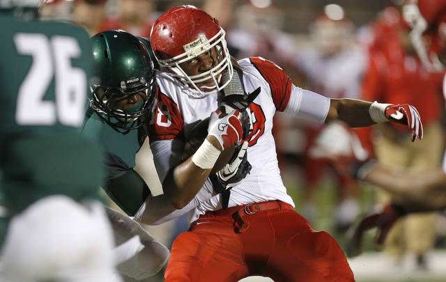 Lawton's Tristan Gooden fights off Edmond Santa Fe's Khari Harding during their high school football game at Wantland Stadium in Edmond, Okla., Thursday, October 11, 2012. Photo by Bryan Terry, The Oklahoman