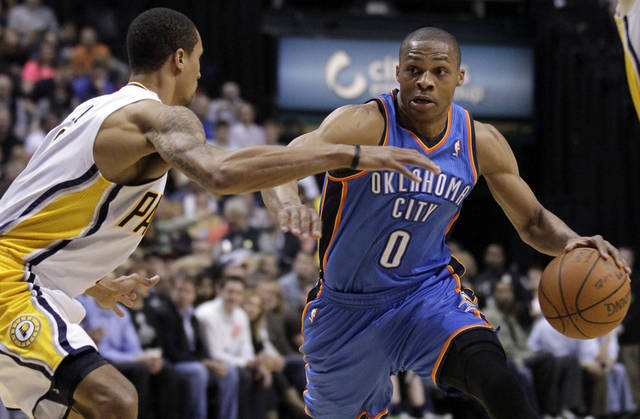 Oklahoma City Thunder guard Russell Westbrook, right, drives on Indiana Pacers guard George Hill in the first half of an NBA basketball game in Indianapolis, Friday, April 6, 2012. (AP Photo/Michael Conroy) ORG XMIT: NAF105