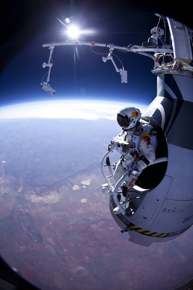 FILE - In this Thursday, March 15, 2012 photo provided by Red Bull Stratos, Felix Baumgartner prepares to jump during the first manned test flight for Red Bull Stratos over Roswell, N.M. On Monday, Oct. 8, 2012 over New Mexico, Baumgartner will attempt to jump higher and faster in a free fall than anyone ever before and become the first skydiver to break the sound barrier. (AP Photo/Red Bull Stratos, Jay Nemeth)