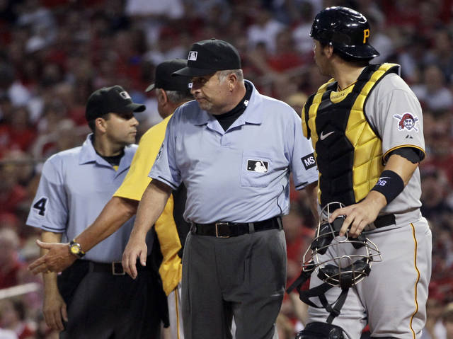 Pittsburgh Pirates catcher Rod Barajas, right, walks off the field after being ejected from a baseball game by home plate umpire Angel Campos, left, as Pirates manager Clint Hurdle, second from left argues with Campos, while umpire crew chief Dale Scott, second from right, stands in the middle during the second inning of the Pirates' baseball game against the St. Louis Cardinals on Wednesday, May 2, 2012, in St. Louis. Hurdle was also thrown out of the game. (AP Photo/Jeff Roberson)