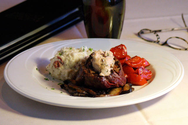 New York Strip Steak - 13 oz. Strip Steak grilled to your preference and topped with Boursin Butter. Served with Mashed Potatoes and Glazed Carrots.