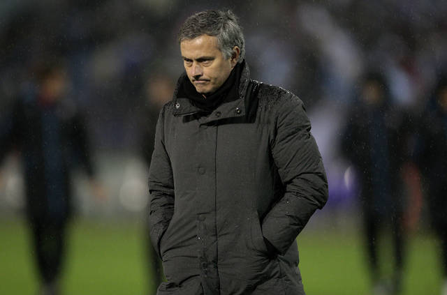 Real Madrid's coach Jose Mourinho from Portugal walks off the pitch during the 1st leg of a last-16 Copa del Rey soccer match against Celta at the Balaídos stadium in Vigo, Spain, Wednesday Dec. 12, 2012. Celta won the match 2-1. (AP Photo/Lalo R. Villar)