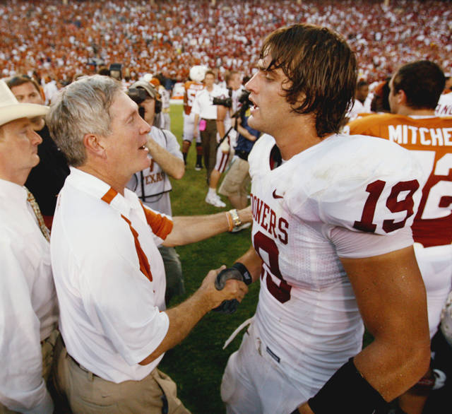 Texas head coach Mack Brown congratulates tight end Joe Jon Finley after the college football game between the University of Oklahoma Sooners (OU) and the University of Texas Longhorns (UT) at the Cotton Bowl on Saturday, Oct. 6, 2007, in Dallas, Texas.  By Steve Sisney, The Oklahoman