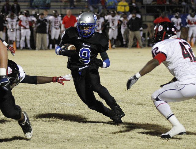 Guthrie's Kai Callins (9) runs the ball during a high school football game between Guthrie and East Central at The Rock in Guthrie, Friday, Nov. 18, 2011.  Photo by Garett Fisbeck, The Oklahoman