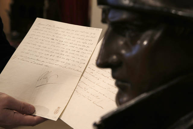 "In this photo taken Wednesday, Nov. 28, 2012, a letter dictated and signed by Napoleon in secret code that declares his intentions ""to blow up the Kremlin"" during his ill-fated Russian campaign is displayed for the media in Fontainebleau, outside Paris. The rare letter, written in unusually emotive language, sees Napoleon complain of harsh conditions and the shortcomings of his grand army. The letter goes on auction Sunday, Dec. 2, 2012. (AP Photo/Christophe Ena)"