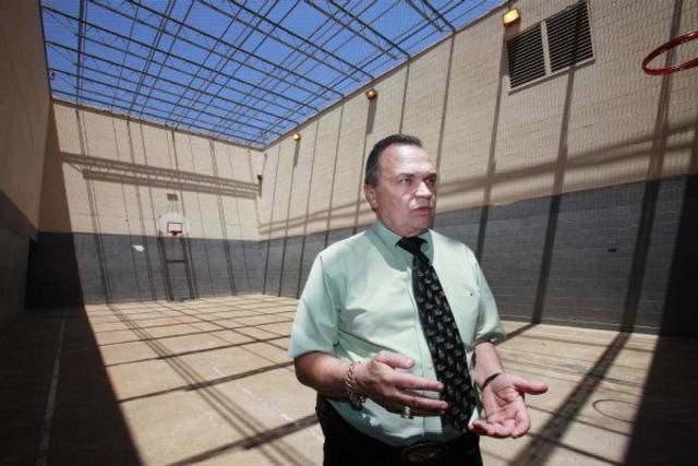 Oklahoma County Sheriff John Whetsel stands in the jail's recreation area, essentially a concrete hole on the top of the building. It's the only outdoor recreation area in the jail. <strong>David McDaniel - The Oklahoman</strong>
