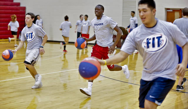 Reggie Jackson works out with students during a visit by the Oklahoma City Thunder to U.S. Grant High School to promote physical fitness on Monday, Jan. 28, 2013, in Oklahoma City, Okla.  Photo by Chris Landsberger, The Oklahoman