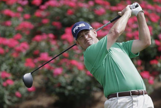 Jeff Maggert hits from the 18th tee during the third round of The Players championship golf tournament at TPC Sawgrass, Saturday, May 11, 2013, in Ponte Vedra Beach, Fla. (AP Photo/John Raoux)