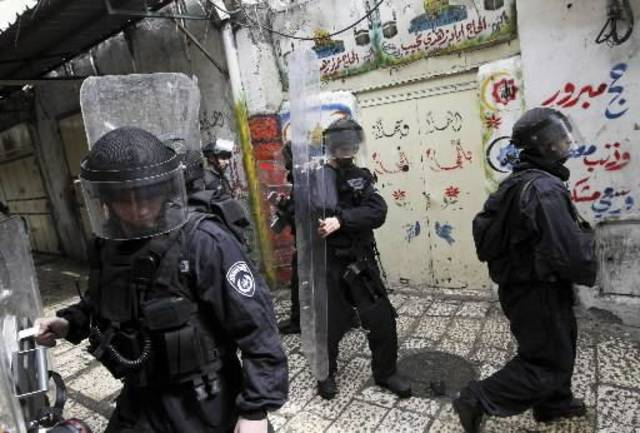 Israeli policemen take positions during clashes with Palestinians youths, not seen, in Jerusalem's Old City, Sunday, Feb. 28, 2010. Israeli police forces stormed The holy compound known to Jews as the  Temple  Mount and to Muslims as the Noble Sanctuary, in Jerusalem on Sunday to disperse masked Palestinian protesters hurling objects at visiting foreign tourists. (AP Photo/Tara Todras-Whitehill)