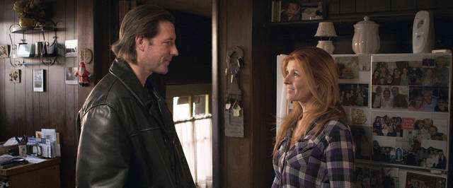 "This undated publicity image released by Tribeca Film shows Edward Burns, left, and Connie Britton in ""The Fitzgerald Family Christmas,"" distributed by Tribeca Film. ""The Fitzgerald Family Christmas,"" from filmmaker Edward Burns, is in limited release beginning Friday, Dec. 7, 2012, in theaters after debuting on iTunes and video on demand. (AP Photo/Tribeca Film)"