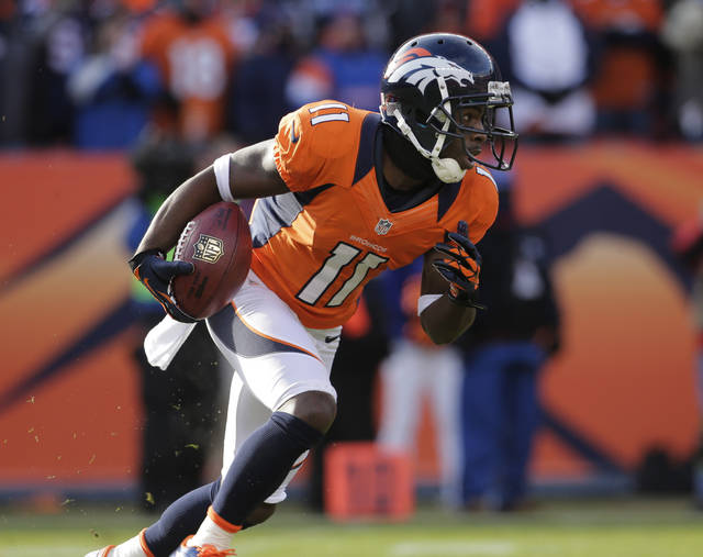 Denver Broncos wide receiver Trindon Holliday returns a punt 90 yards for a touchdown against the Baltimore Ravens in the first quarter of an AFC divisional playoff NFL football game, Saturday, Jan. 12, 2013, in Denver. (AP Photo/Charlie Riedel)