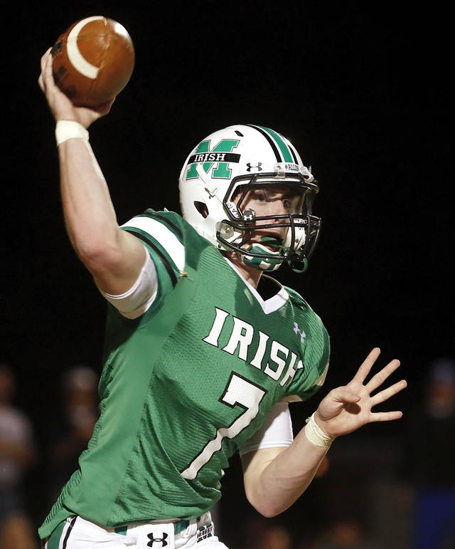 McGuinness quarterback Jacob Lewis finds a target.  Deer Creek Antlers vs. Bishop McGuinness Fighting Irish at Pribil Stadium Friday night, Nov. 2, 2012.    Photo by Jim Beckel, The Oklahoman