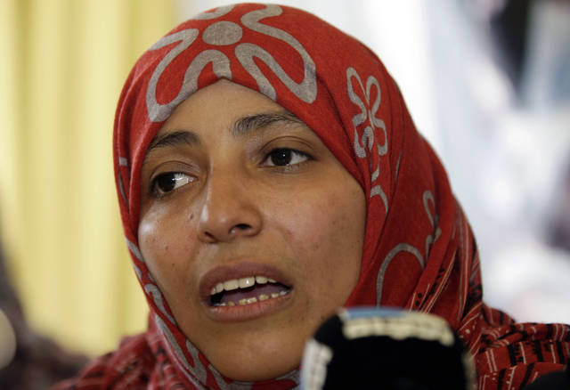 Yemeni activist Tawakkul Karman speaks to journalists after the announcement of the 2011 Nobel Peace Prize in Sanaa, Yemen, Friday, Oct. 7, 2011. The 2011 Nobel Peace Prize was awarded Friday to Liberian President Ellen Johnson Sirleaf, Liberian peace activist Leymah Gbowee and Tawakkul Karman of Yemen for their work on women's rights. (AP Photo/Hani Mohammed)