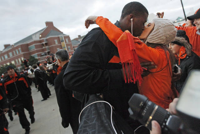 OSU player Davidell Collins (98) kisses his girlfriend, Nikki Gunter, an OSU student from Mustang, Okla., during the Spirit Wak before the Bedlam college football game between the Oklahoma State University Cowboys (OSU) and the University of Oklahoma Sooners (OU) at Boone Pickens Stadium in Stillwater, Okla., Saturday, Dec. 3, 2011. Photo by Nate Billings, The Oklahoman