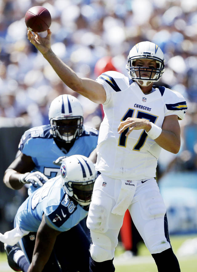 San Diego Chargers quarterback Philip Rivers throws a pass against the Tennessee Titans during the first quarter of an NFL football game, Sunday, Sept. 16, 2012, in San Diego. (AP Photo/Lenny Ignelzi)