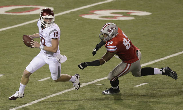 Washington State quarterback Connor Halliday (12) scrambles away from UNLV defensive lineman Jordan Sparkman (85) in the third quarter during an NCAA college football game, Friday, Sept. 14, 2012, in Las Vegas. (AP Photo/Julie Jacobson)