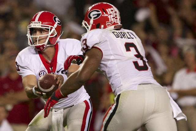 Georgia quarterback Aaron Murray hands the ball off to running back Todd Gurley, during the second quarter of an NCAA college football game against South Carolina, at Williams-Brice Stadium in Columbia, S.C., Saturday, Oct. 6, 2012. (AP Photo/Brett Flashnick)