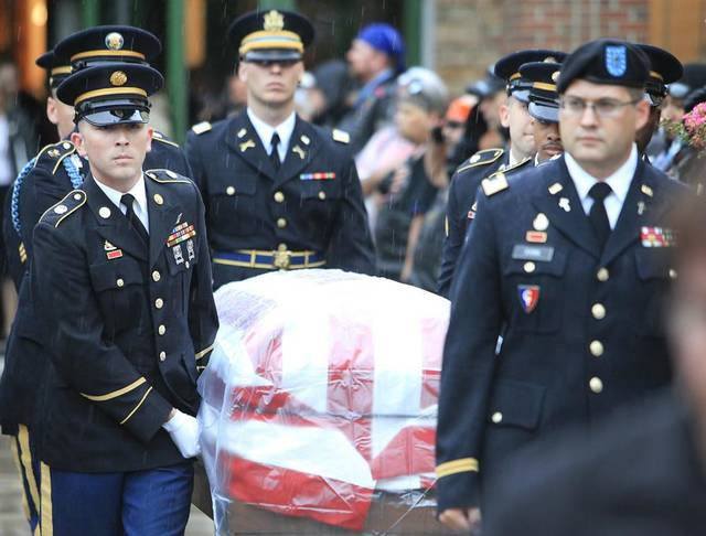 Honor guard carries the flag draped coffin during the funeral for 2nd Lt Jered Ewy, 33, of Edmond, at Henderson Hills Baptist Church, Thursday, August 11, 2011.       Photo by David McDaniel, The Oklahoman  ORG XMIT: KOD