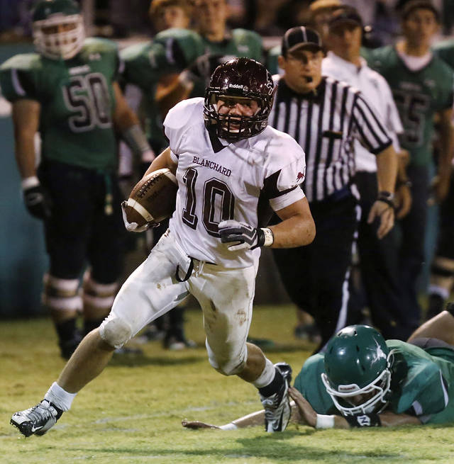 Blanchard runningback Braden Stringer leaves a Jones defender face-down in the turf as he goes along the sideline on a run to the right side of the field to score his team's second touchdown.  Blanchard vs. Jones high school football at Jones  High School on Friday, Oct. 12, 2012.   Photo by Jim Beckel, The Oklahoman