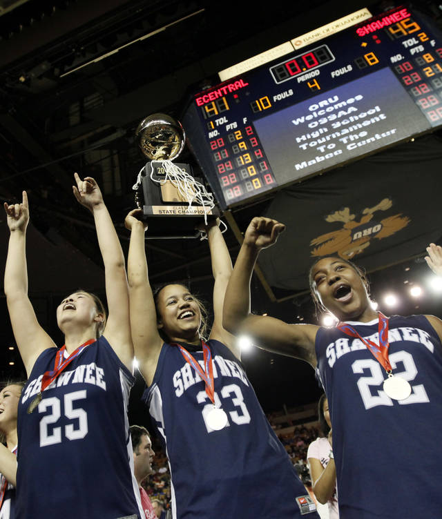 CELEBRATION: From left, Shawnee's Micaela Yu (25), Kelsee Grovey (23) and Diamond Young (22) celebrate with the gold ball championship trophy after the Class 5A girls high school basketball state tournament championship game between Shawnee and East Central at the Mabee Center in Tulsa, Okla., Saturday, March 10, 2012. Shawnee won, 45-41. Photo by Nate Billings, The Oklahoman