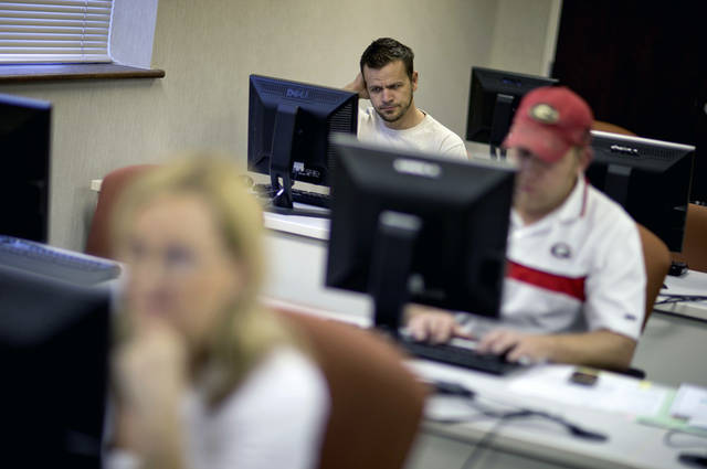 Scott Marshall, top, of Calhoun, Ga., files for unemployment recently in Dalton, Ga.  AP Photo